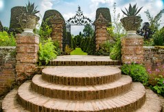 Steps up to the splendid lawns and shrubbery