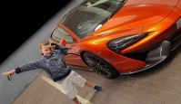KEW Car Park - McLaren sports car inspires Dan's Usain Lightening Bolt type pose